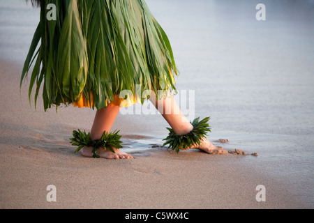 Hula dancer dancing on beach in Maui Hawaii slight soft focus created by movement - Stock Photo