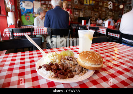 pulled pork bbq platter on cafe table served with disposable plates and plastic cutlery Lynchburg , tennessee , - Stock Photo