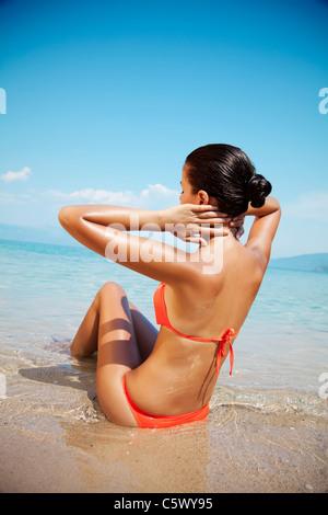female in bikini enjoying the sun - Stock Photo