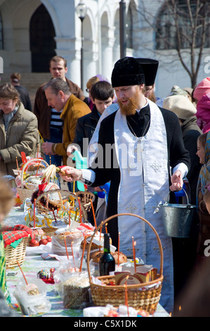 A russian orthodox priest blessing the easter gifts stock photo russian orthodox priest on easter sunday novodevichy convent moscow russia stock photo negle Images