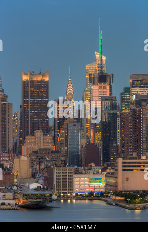 The Chrysler Building, Bank of America Tower, and other buildings near 42nd Street during evening twilight as viewed - Stock Photo