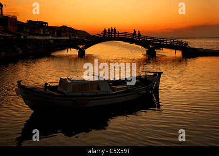 Sunset at Lefkas town, at the small marina for the fishing boats with the nice wooden bridge. Ionian islands, Greece. - Stock Photo