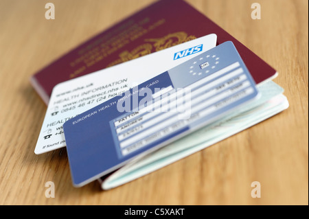 UK NHS EHIC card and passport - Stock Photo