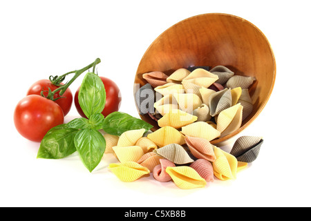 colorful pasta tomato and basil on a white background - Stock Photo