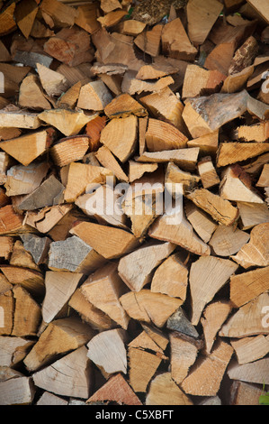 a stack of cut firewood for a log burning stove UK - Stock Photo