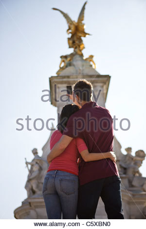 A young couple taking a picture of the Victoria Memorial - Stock Photo