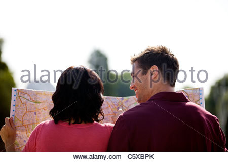 A young couple looking at a map of London - Stock Photo