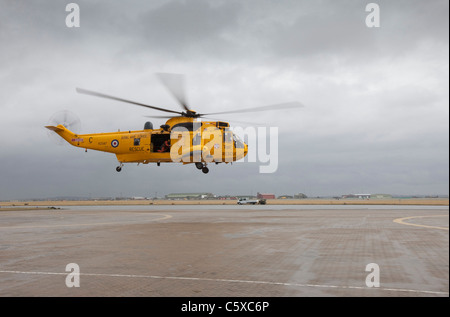 An RAF Westland Sea King search and Rescue (SARS) helicopter takes off from it's base at RAF Valley on Anglesey, - Stock Photo