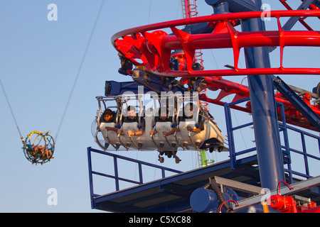 Visitors to Luna Park in Coney Island enjoy the Screaming Eagle ride - Stock Photo