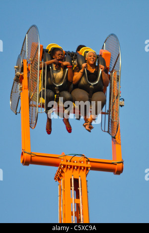 Visitors to Luna Park in Coney Island enjoy the Zenobio ride - Stock Photo
