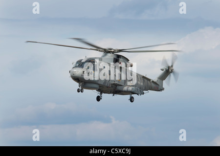 British Royal Navy Helicopter Augusta Westland EH-101 Merlin HM1 ZH860 from 814 Naval Air Squadron arrives at RAF - Stock Photo