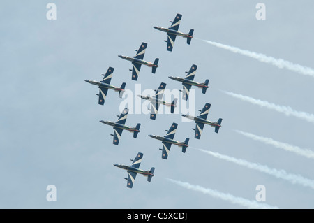 Italian airforce aerobatic display team Il Frecce Tricolori paint the sky with the their smoke trails at the 2011 - Stock Photo