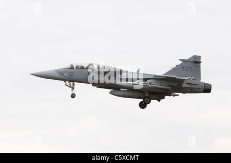 Swedish Air Force Saab Gripen JAS-39D Number 825 arrives at RAF Fairford for the 2011 Royal International Air Tattoo - Stock Photo