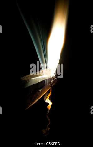 Magnesium ribbon burns. A typical high school chemistry experiment - Stock Photo