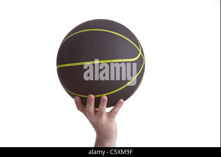 close up of player holding basketball in the air