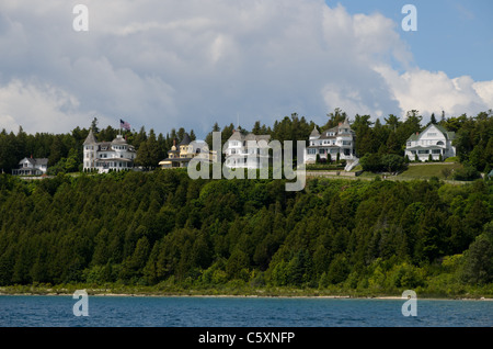Row of Victorian historic houses on Mackinac Island, Michigan - Stock Photo