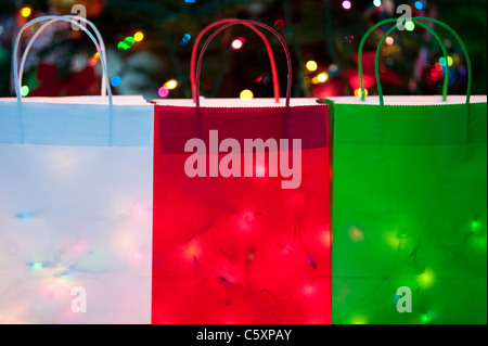 Colorful Christmas bags filled with Christmas Lights - Stock Photo