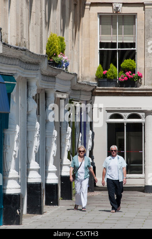 The white female sculptures around the buildings at Montpellier Walk in the Spa town of Cheltenham. - Stock Photo