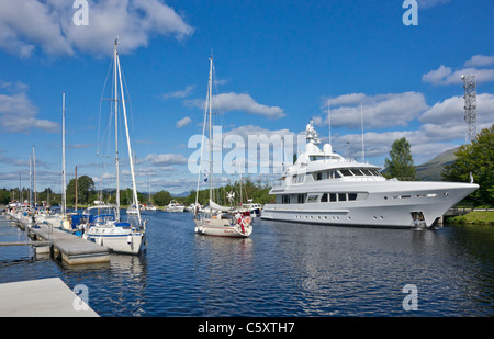 Yachts & motor boats moored on the Caledonian Canal in Banavie near Fort William in Scotland with Danish flag yacht - Stock Photo