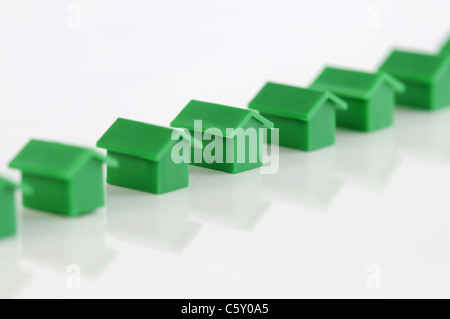 Row of green model houses - Stock Photo