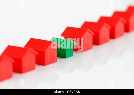 Row of model houses. Conceptual real estate image. - Stock Photo