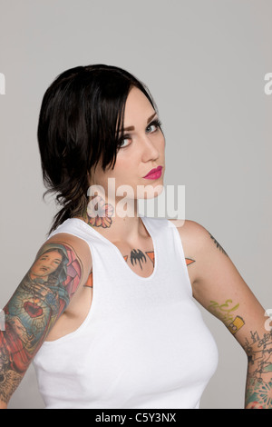 Portrait of girl with tattoos - Stock Photo