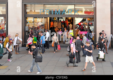 London street scene view from above looking down at shoppers in & around Primark clothing retail shopping store - Stock Photo