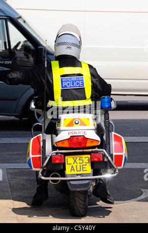Metropolitan police motorbike patrol watching London traffic Marble Arch London England UK - Stock Photo