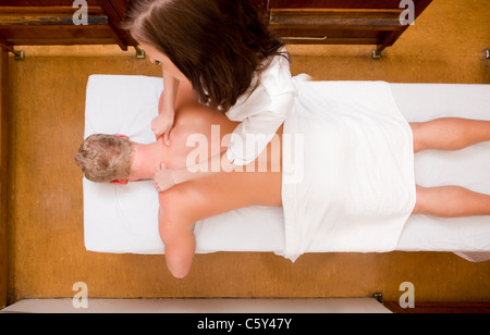 An above view of a man receive a massage in an old style spa - Stock Photo