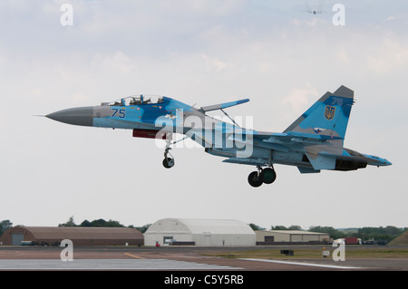 Ukrainian Air Force Sukhoi Su-27UB air superiority fighter from the 831st Fighter Aviation Regiment lands at RAF - Stock Photo