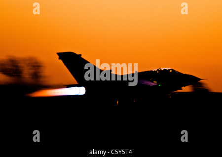 Tornado gets airborne at dusk - Stock Photo