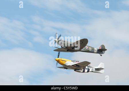 British Supermarine Spitfire Mark IXB number MH434 ( built in 1943) and North American P-51D Mustang ' Ferocious - Stock Photo
