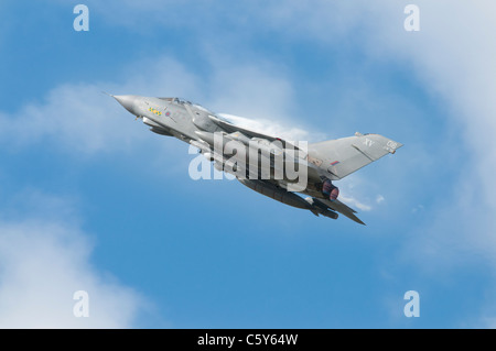 British Panavia Tornado GR4 Multi Role Combat Aircraft Desingation ZD410 from RAF Lossiemouth Scotland flies out - Stock Photo