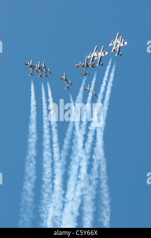 The Italian airforce aerobatic display team Il Frecce Tricolori perform an impressive formation split climbing vertically - Stock Photo