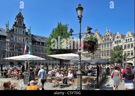 Tourists sitting on terrace of pavement café on the Grote Markt / Main Square / Grand Place in Antwerp city in summer, - Stock Photo
