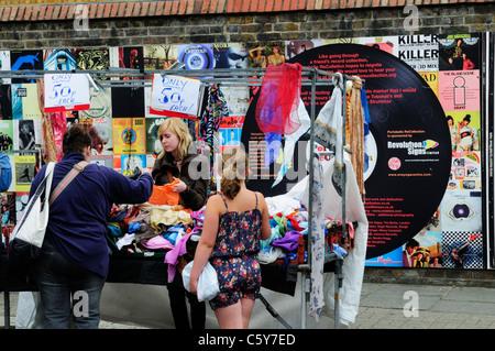 Shopping on Portobello Road Market, Notting Hill, London, England, UK - Stock Photo
