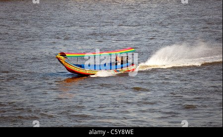 A Long Tail Boat on Chao Phraya River, Bangkok, Thailand - Stock Photo