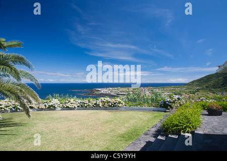 Triopical Paradise - View over Mosteiros on Sao Miguel Island in the Azores - Stock Photo