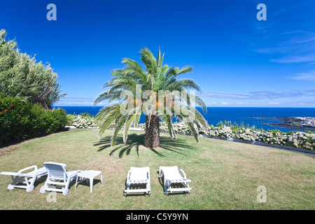 Tropical holiday view over Mosteiros, Sao Miguel Island in the Azores - Stock Photo