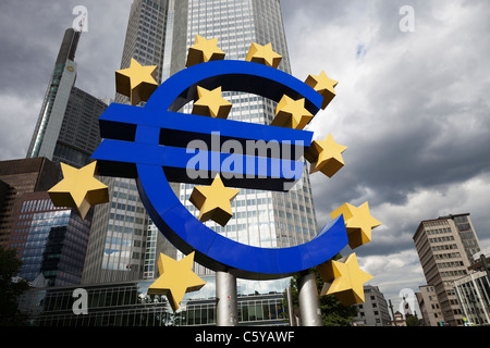 A giant Euro currency symbol stands outside the headquarters of the European Central Bank July 14, 2011 in Frankfurt, - Stock Photo
