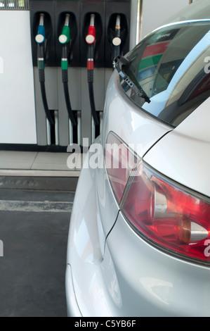 Gray car at a gas station. - Stock Photo