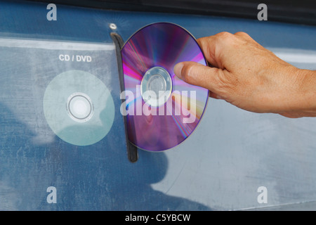 Recycling container for CDs and DVDs in street in Spain - Stock Photo
