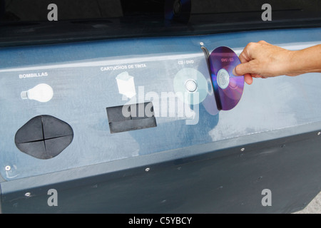 Recycling container for CDs/DVDs, ink cartridges and bulbs in street in Spain - Stock Photo