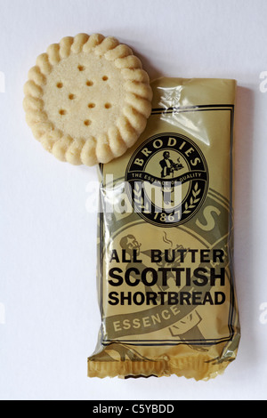 packet of Brodies all butter Scottish Shortbread biscuits showing one out of packet isolated on white background - Stock Photo