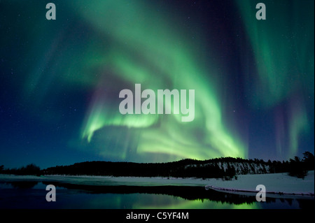 Northern Lights, also known as Aurora Borealis above the snowy tundra. Lapland, Finland. - Stock Photo