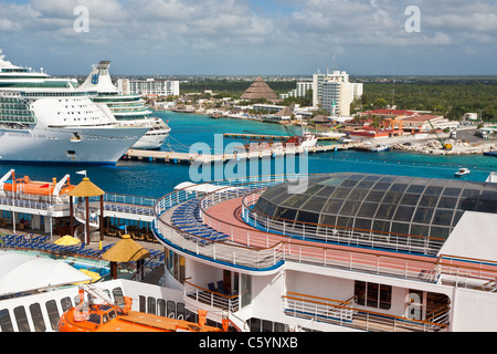 Carnival Ecstasy and two Royal Caribbean cruise ships at port in Cozumel, Mexico in the Caribbean Sea - Stock Photo