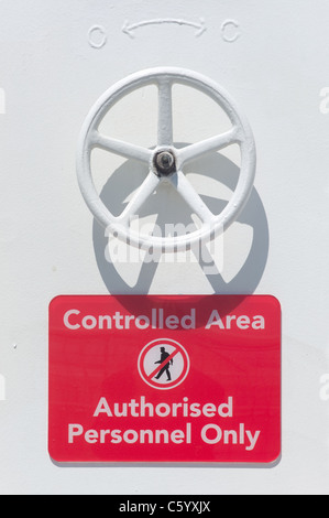 Controlled Area Sign on a ship - Stock Photo