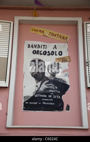 Cinema Poster in Orgosolo village, Nuoro Province, Sardinia, Italy - Stock Photo