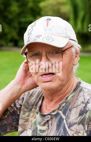 London Parliament Hill Hampstead Heath portrait of an angler or fisherman elderly man male with baseball cap Leo - Stock Photo