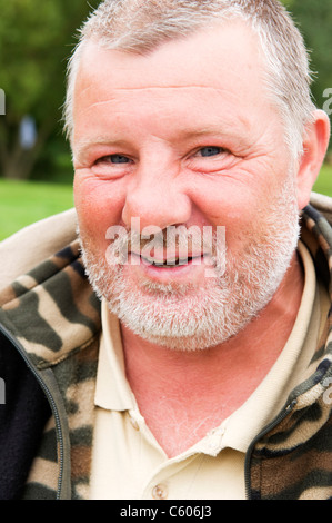 London Parliament Hill Hampstead Heath portrait of an angler or fisherman middle aged man or male in camouflage - Stock Photo